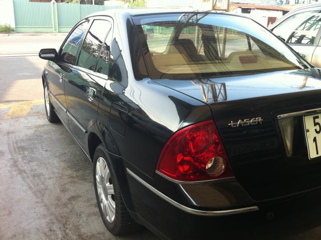 Cần bán gấp Ford Laser xli đời 2005, màu đen, như mới