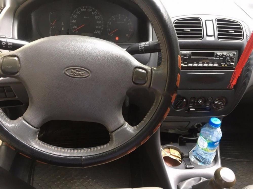 Bán Ford Laser 1.6MT đời 2000, màu trắng số sàn, giá tốt