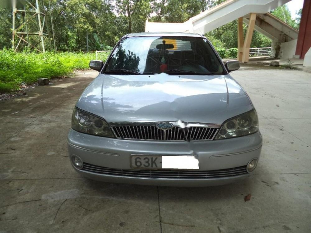 Bán Ford Laser Deluxe 1.6 đời 2002, màu bạc còn mới
