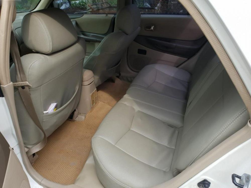 Bán Ford Laser 1.8 AT đời 2003, màu trắng, xe gia đình tên tư nhân