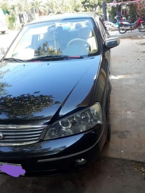 Cần bán xe Ford Laser MT sản xuất 2004, màu đen, xe nhập chính chủ