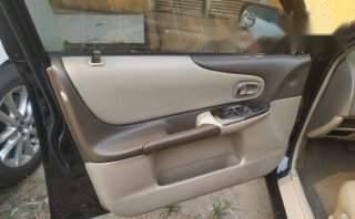 Bán Ford Laser 1.8 AT 2004, màu đen, giá tốt