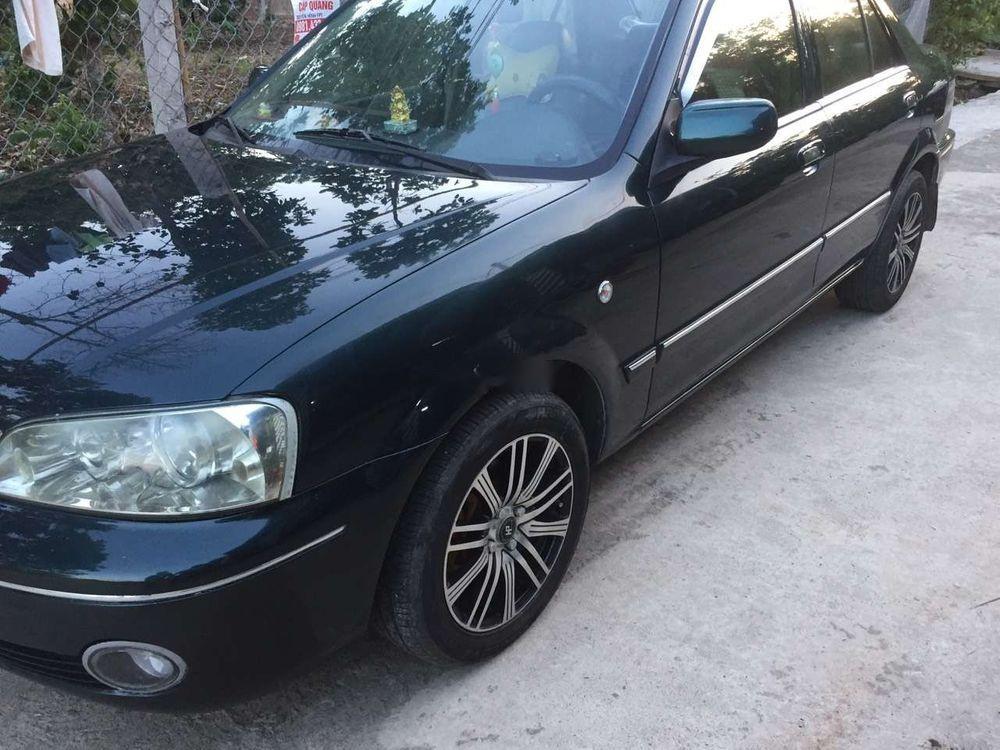 Bán Ford Laser năm sản xuất 2004, màu đen, xe nhập