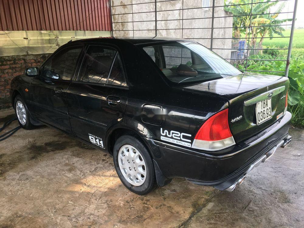 Chính chủ bán Ford Laser đời 2001, màu đen, xe nhập