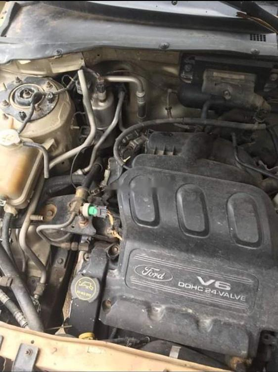 Bán xe Ford Escape đời 2002, màu vàng cát, giá chỉ 90 triệu