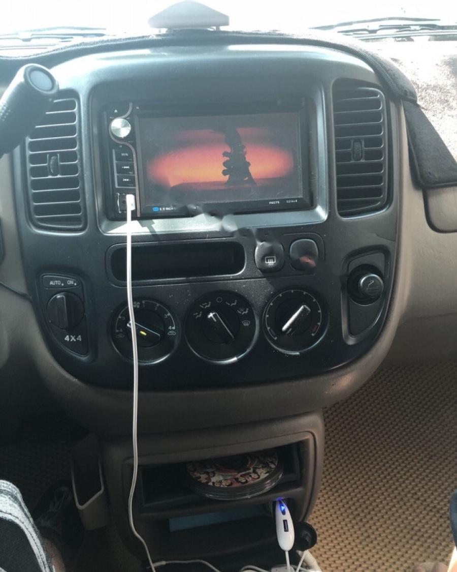 Cần bán Ford Escape đời 2004, màu đen, nhập khẩu số tự động
