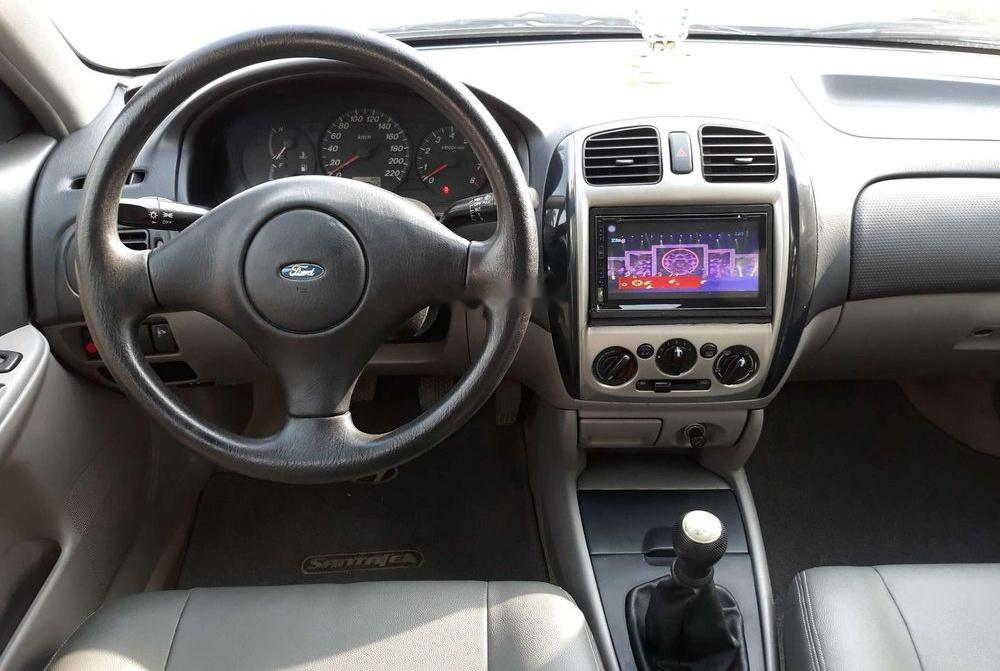 Cần bán xe Ford Laser đời 2004, màu bạc