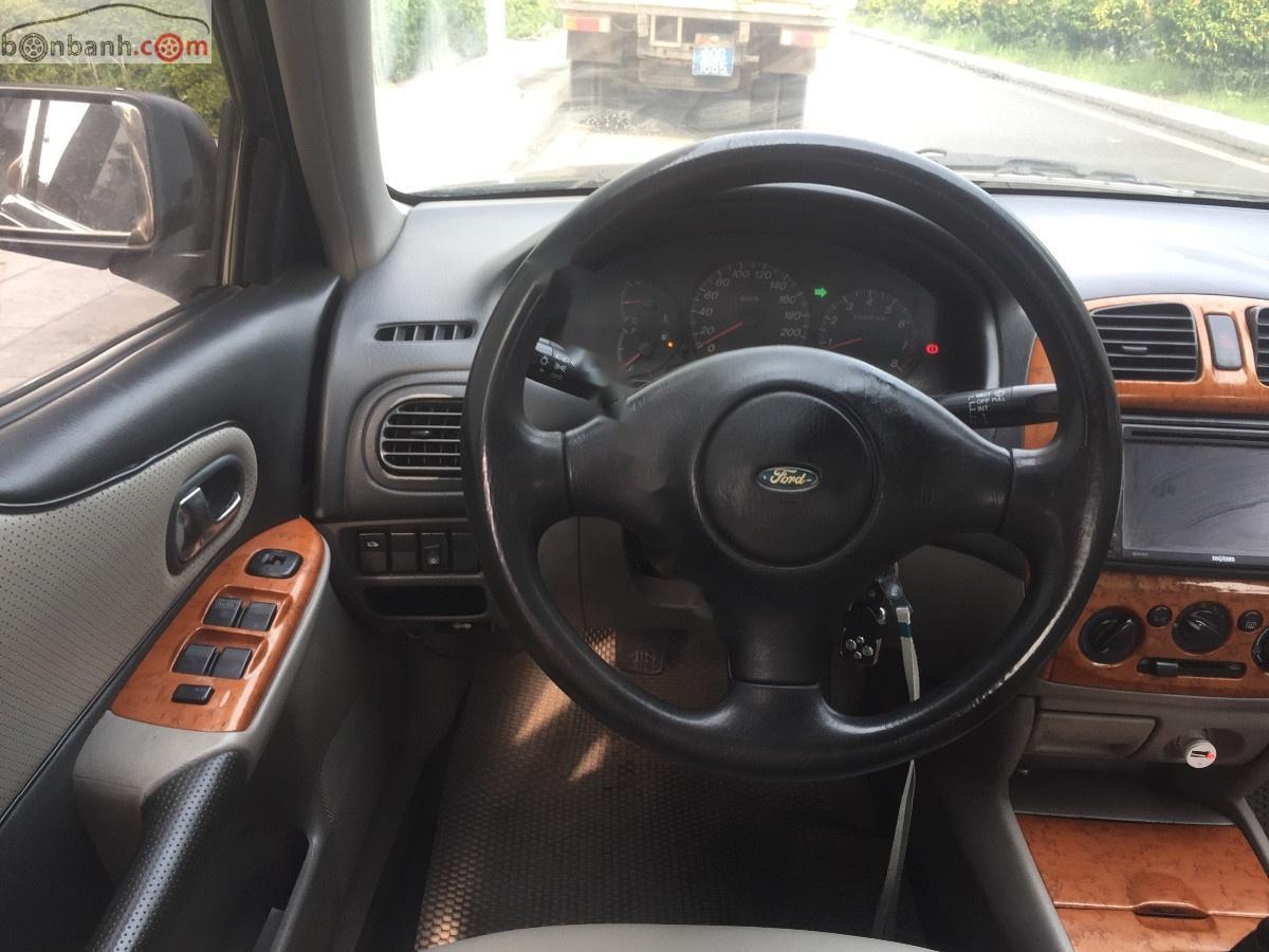 Cần bán Ford Laser LX 1.6 MT đời 2002, màu đen, số sàn, 143tr