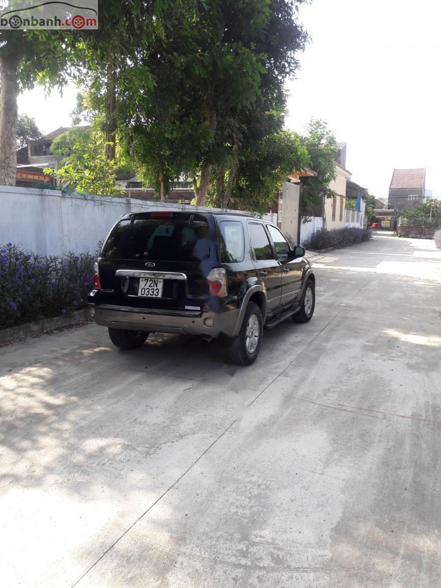 Cần bán lại xe Ford Escape đời 2004, màu đen, nhập khẩu nguyên chiếc