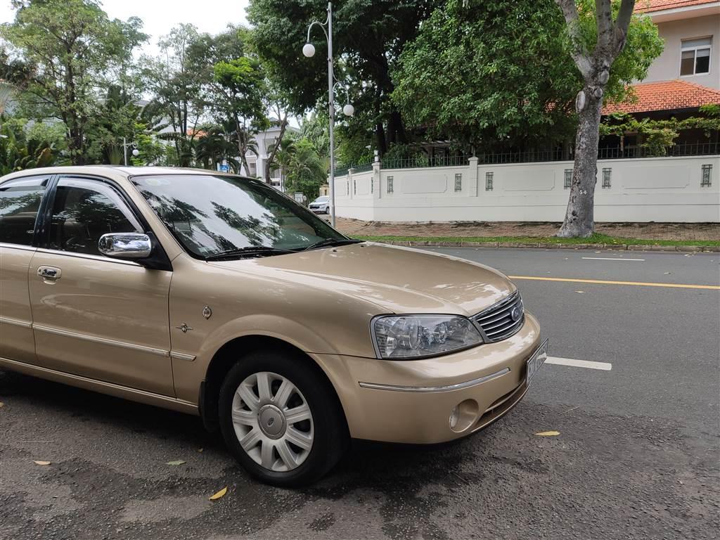 Ford Laser 1.8 số tự động, vàng cát 2004