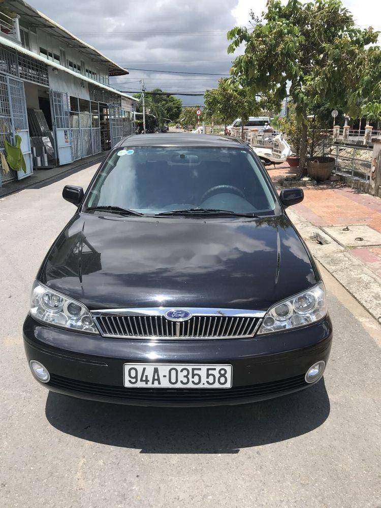 Cần bán Ford Laser đời 2002, màu đen, xe nhập chính chủ, giá 180tr