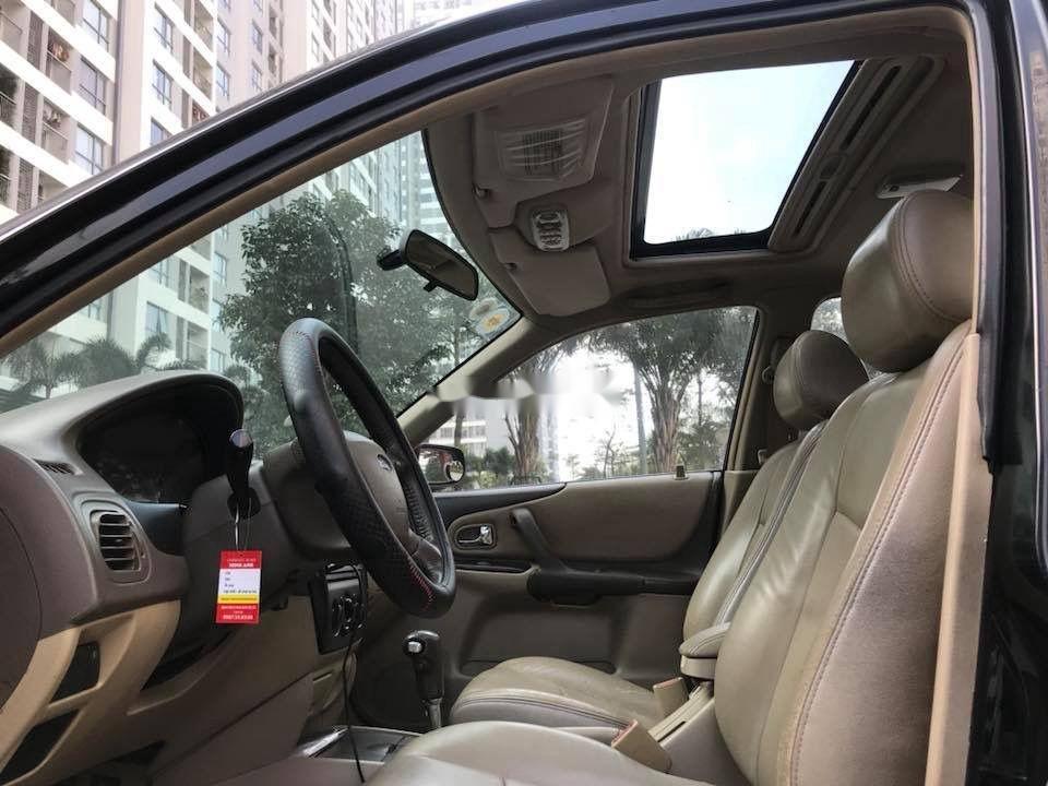 Bán ô tô Ford Laser Ghia AT năm sản xuất 2006, màu đen xe gia đình