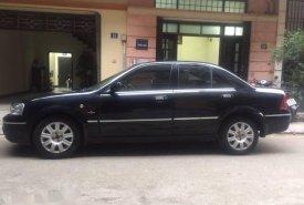 Cần bán lại xe Ford Laser Ghia 1.8 sản xuất 2004, màu đen số tự động giá 270 triệu tại Hà Nội