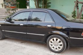 Bán ô tô Ford Laser Ghia 1.8 AT đời 2004, màu đen, giá chỉ 259 triệu giá 259 triệu tại Hà Nội