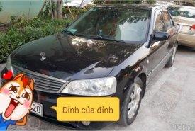 Bán ô tô Ford Laser GHIA 1.8 AT sản xuất năm 2004, màu đen giá 259 triệu tại Hà Nội